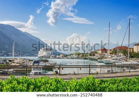 Mediterranean old town atmosphere in bay with yachts. Kotor bay of Montenegro. - stock photo