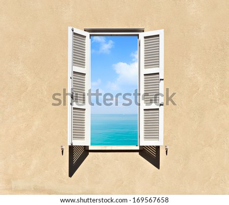 Mediterranean open window with shutters and sea panoramic view  - stock photo