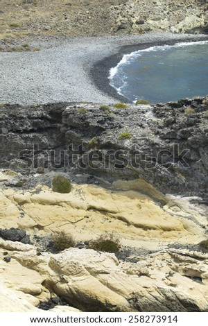 Mediterranean pebble beach and rocks in Almeria, Spain. Vertical