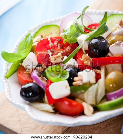 Mediterranean salad with goat cheese and walnuts