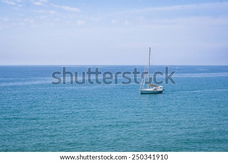 Mediterranean scene.  Sailing boat on the water