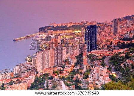 Mediterranean sea and tall buildings of Monte Carlo at dusk, Monaco, French Riviera - stock photo