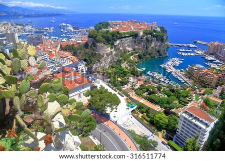 Mediterranean sea and the harbor and buildings of Monaco, French Riviera - stock photo