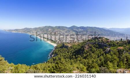 Mediterranean Sea - Beach in Alanya, Alanya Castle, Mosque - Turkey - stock photo