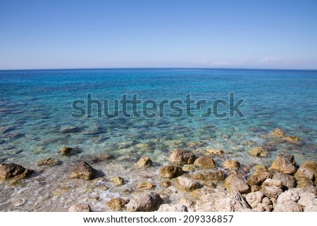 Mediterranean sea in Greece: Ocean background with coast, water and blue horizon.