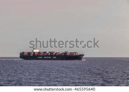 MEDITERRANEAN SEA, INTERNATIONAL WATERS - JULY 25, 2016: View of of a China Shipping Line container ship crossing the mediterranean sea between Italian main land and Corsica
