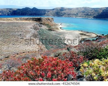 mediterranean sea landscape view of beach and mountains on Crete island - stock photo
