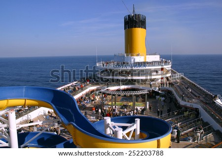 MEDITERRANEAN SEA - NOVEMBER 11: Passengers enjoy a sunny day on the deck cruise ship Costa Magica, while sailing the Mediterranean Sea on November 11, 2007. - stock photo
