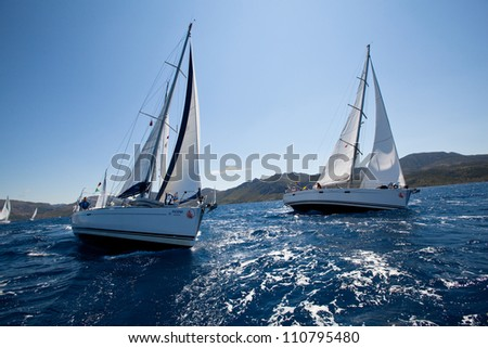 MEDITERRANEAN SEA, TURKEY- MAY 29: Boats Competitors During of sailing regatta Sail & Fun Trophy 2012 from Marmaris to Fethiye, May 29, 2012 in the Mediterranean Sea, Turkey. - stock photo