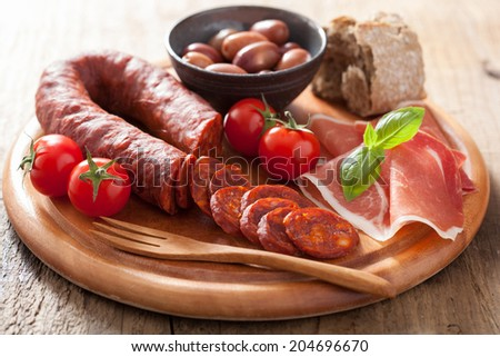 mediterranean snack chorizo parma olives tomatoes - stock photo