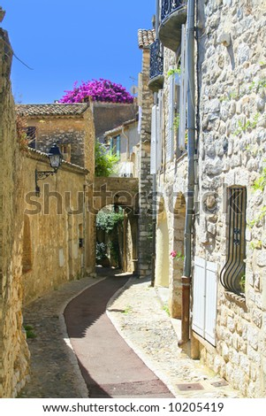 Mediterranean street in an old village from the Middle Ages in the south of France. - stock photo