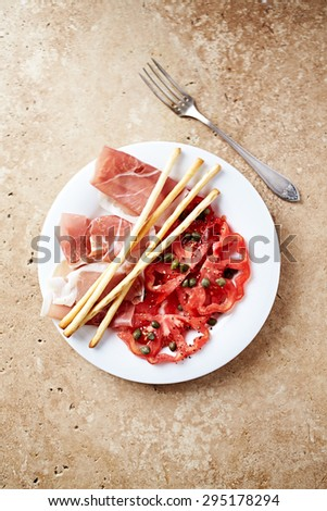 Mediterranean-style antipasto on a plate - stock photo