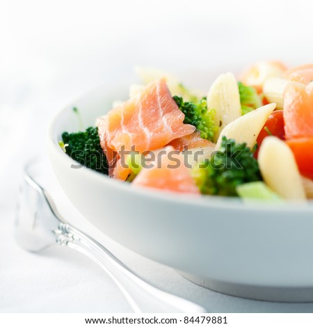 Mediterranean-style pasta salad with salmon and vegetables - stock photo