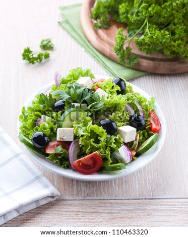 Mediterranean style salad with feta and olives - stock photo