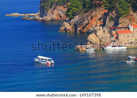 Mediterranean town and harbor on the shores of Adriatic sea - stock photo