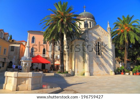 Mediterranean town square with fountain and church