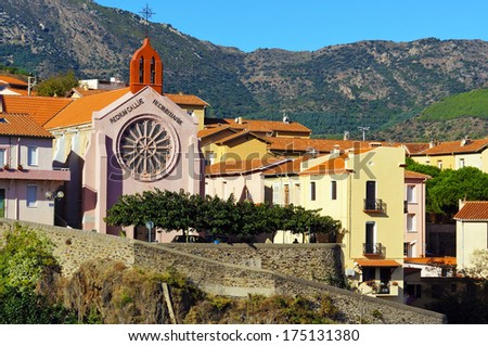 Mediterranean village of Cerbere and its church with mountain in background, Cote Vermeille, Pyrenees Orientales, Roussillon, France - stock photo