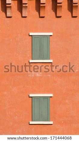 mediterranean window on orange wall - stock photo