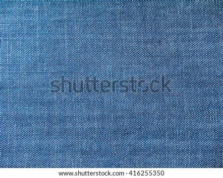 Medium blue striped washed denim fabric background - stock photo