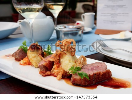Medium rare fried duck breast with fried onion and sauerkraut, modern czech cuisine - stock photo