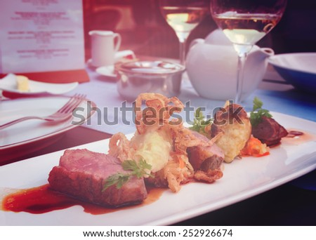 Medium rare fried duck breast with fried onion and sauerkraut, modern czech cuisine, toned image - stock photo