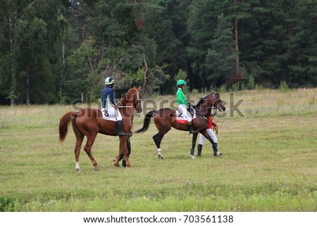 Medvedev, RUSSIA, AUGUST 26, 2017: Open championship on horse racing and jumping devoted to the day of the settlement of Medvedeva - paddock horses with jockeys - warm-up before horse racing