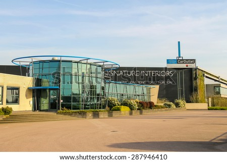 Meerkerk, municipality Zederik, Netherlands - April 13, 2015: Offices companies CarOutlet and  DK Home on the outskirts of Meerkerk, Netherlands