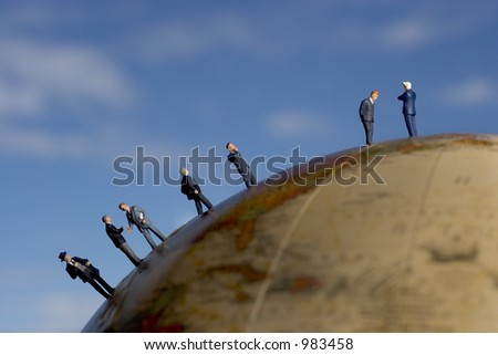 Meet the boss, business figures in a line on a globe