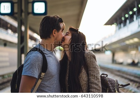 Meeting a young couple at the central station. The joy of meeting lovers. Meeting your beloved at the train station