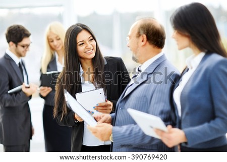 meeting business partners before presentation in the lobby of th - stock photo
