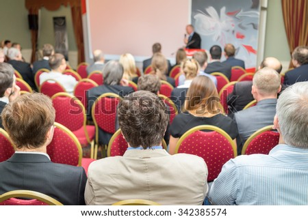 meeting, conference, presentation in auditorium - stock photo