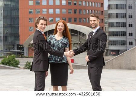 Meeting Handshake of two business men outdoors - stock photo