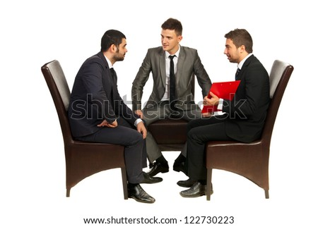Meeting of three business men sitting on chairs and having conversation isolated on white background