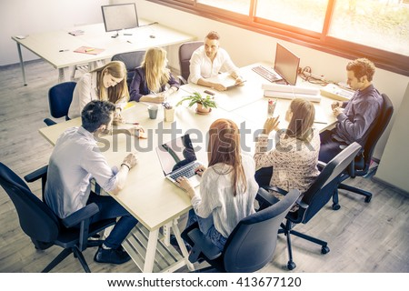 Meeting of young business people in a modern office - Start up company, workers brainstorming - stock photo