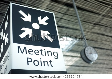 Meeting point sign at the airport - stock photo