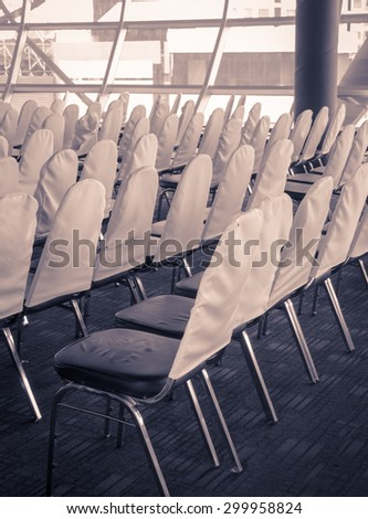 Meeting room chair lined up in vintage filter effect
