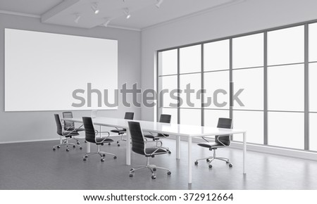 meeting room with a table in the center, a laptop on it, seven black chairs around it. A blank frame on the white wall. Window to the right. Concept of negotiations. 3D rendering - stock photo