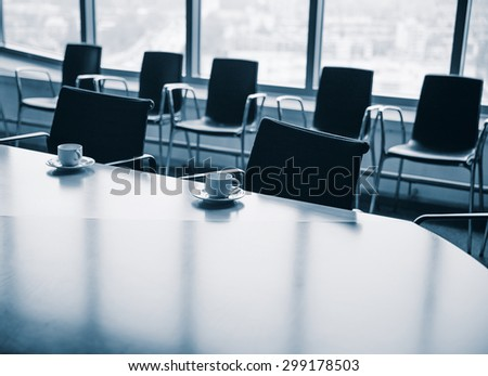 Meeting room with coffee cups before meeting