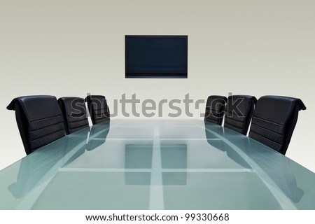 Meeting room with glass top table , armchairs and television. Office interior - stock photo