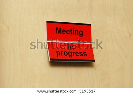 """Meeting room with label  """"Meeting in progress"""" - stock photo"""