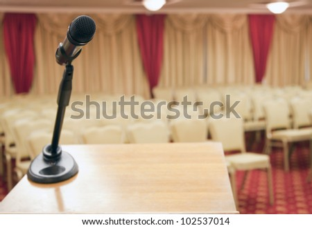 Meeting room with microphone on the table - stock photo