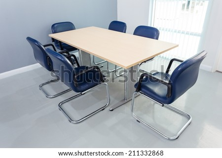 Meeting table in the room - stock photo