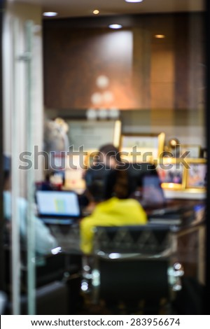 Meeting with business customer in defocused blur concept