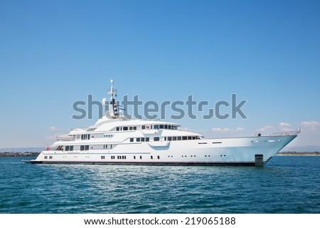 Mega motor yacht on the blue ocean. - stock photo