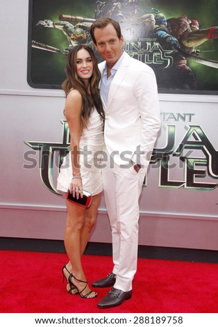 "Megan Fox and Will Arnett at the Los Angeles premiere of ""Teenage Mutant Ninja Turtles"" held at the Regency Village Theatre in Los Angeles on August 3, 2014. - stock photo"