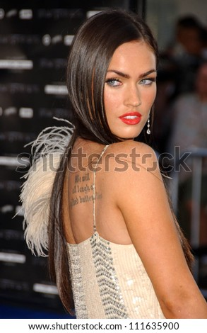 "Megan Fox at the Los Angeles Premiere of ""Transformers"". Mann's Village Theater, Los Angeles, CA. 06-27-07 - stock photo"