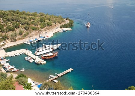 MEGANISSI, GREECE - AUGUST 31, 2008: Looking down from Spartohori onto boats moored in Spilia bay on the Greek island of Meganissi. The small Ionian island has a population of around 1100 people. - stock photo