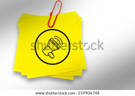 Megaphone graphic against sticky note with red paperclip - stock photo