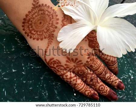 Mehndi Flower Image : Mehndi hands white hibiscus flower on stock photo