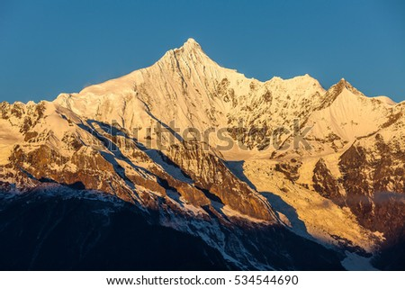 Meili Snow Mountain sunrise, also known as Kawa Karpo, in Deqin County of Yunnan Province.